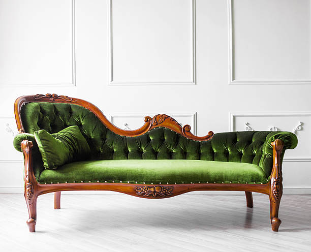 sofa against white wall - antique stock pictures, royalty-free photos & images