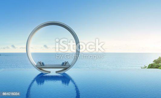 istock Sofa and swimming pool in luxury sea view hotel 664016034