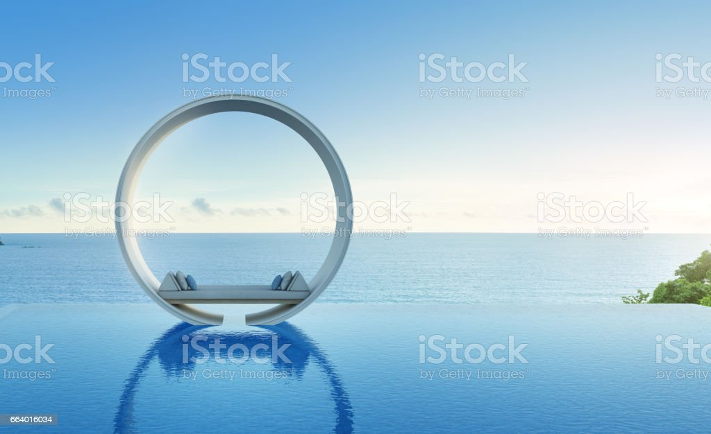 Sofa and swimming pool in luxury sea view hotel stock photo