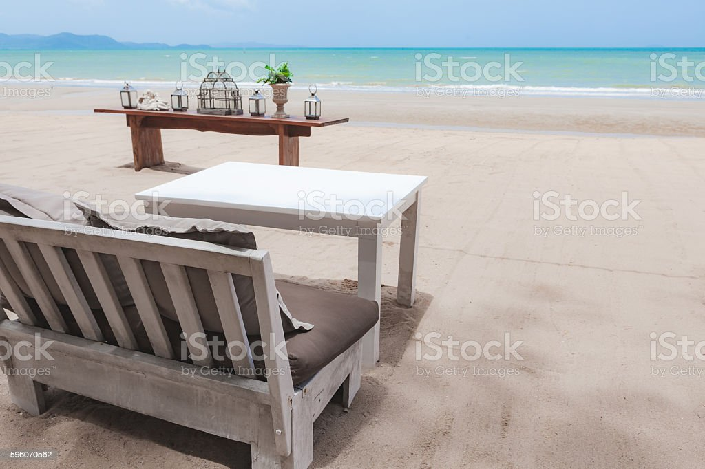 Sofa and table on the beach royalty-free stock photo