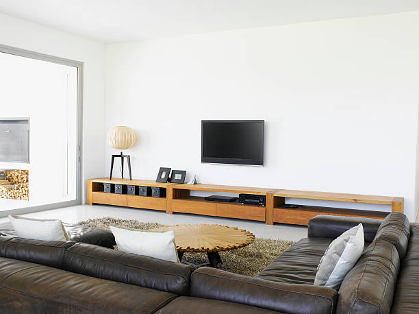 sofa and television in living room of modern home - flat screen stock photos and pictures