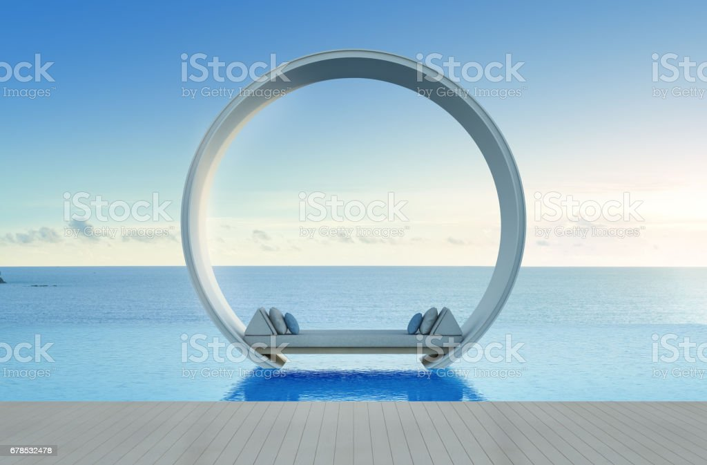 Sofa bed and swimming pool in luxury sea view hotel stock photo