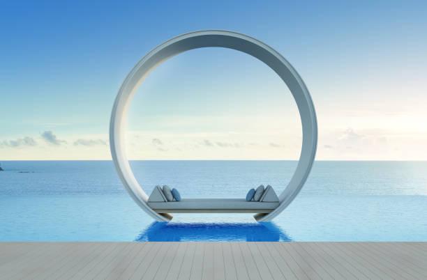 sofa-bett und schwimmbad in luxus meer hotel ansehen - pool rund stock-fotos und bilder