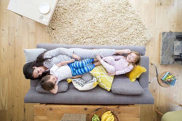 Sofa Cuddles with Mum stock photo