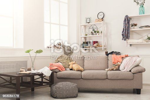 istock Sofa in messy room 953084178