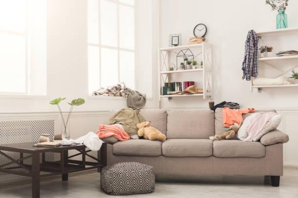 sofa in messy room - desarrumação imagens e fotografias de stock