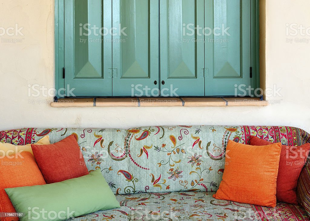 Sofa in the porch of a Greek island house royalty-free stock photo