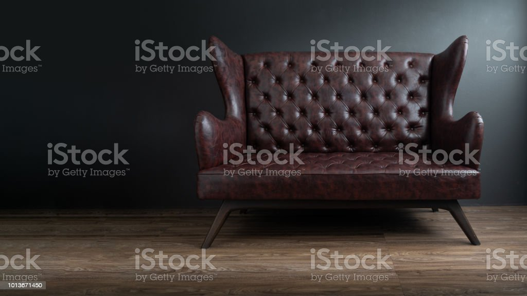 Admirable Sofa Of Black Leather Standing In Center On Concrete Floor Gmtry Best Dining Table And Chair Ideas Images Gmtryco