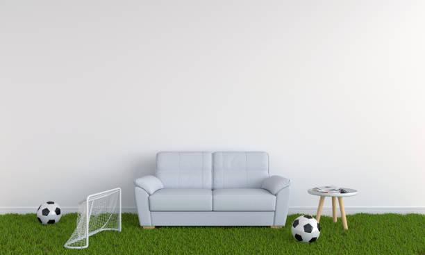 sofa auf dem rasen im weißen wohnzimmer, 3d rendering - fußball themenzimmer stock-fotos und bilder