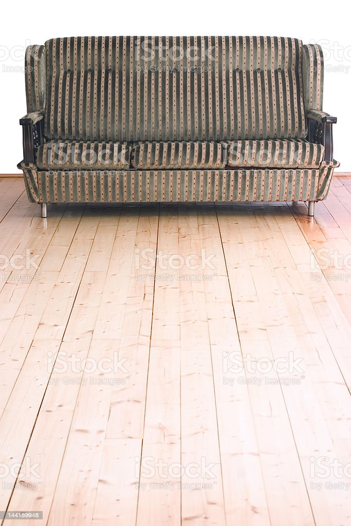 Sofa on wooden floor royalty-free stock photo