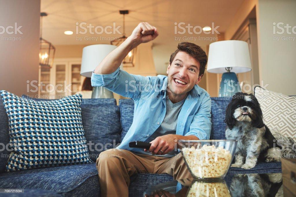 Sofa, snacks, sports. The ultimate fan combo stock photo