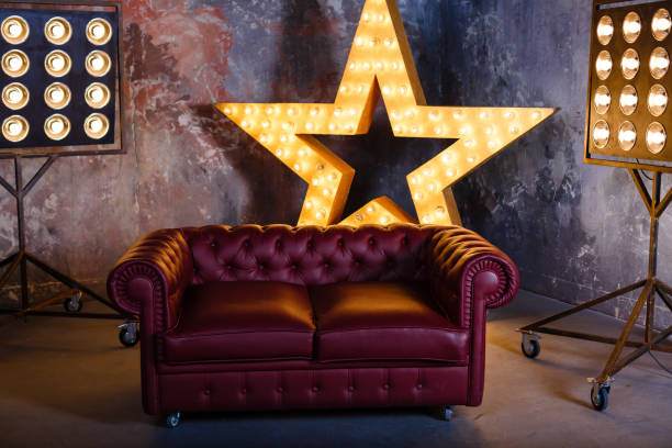 sofa star lamp - celebrities stock pictures, royalty-free photos & images