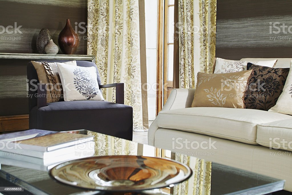 Sofa, table and vases in living room stock photo
