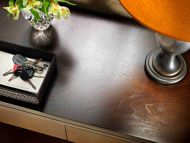 Sofa Table with Keys Lifestyle shot. Close up  from overhead of a sofa or entry hall table to depict someone's home. Large area of wood table left blank for copy space. Shot with a medium format camera and digital back. burwellphotography stock pictures, royalty-free photos & images