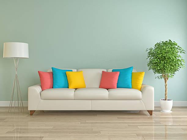 sofa mit bunten kissen - kissen grün stock-fotos und bilder