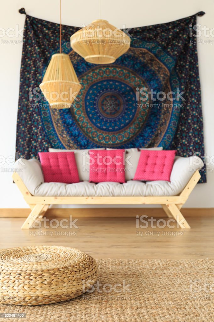 Sofa with material on the wall stock photo