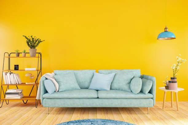 Sofa with Orange Wall stock photo