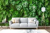 istock Sofa with Plants on Wall Background 1225582818
