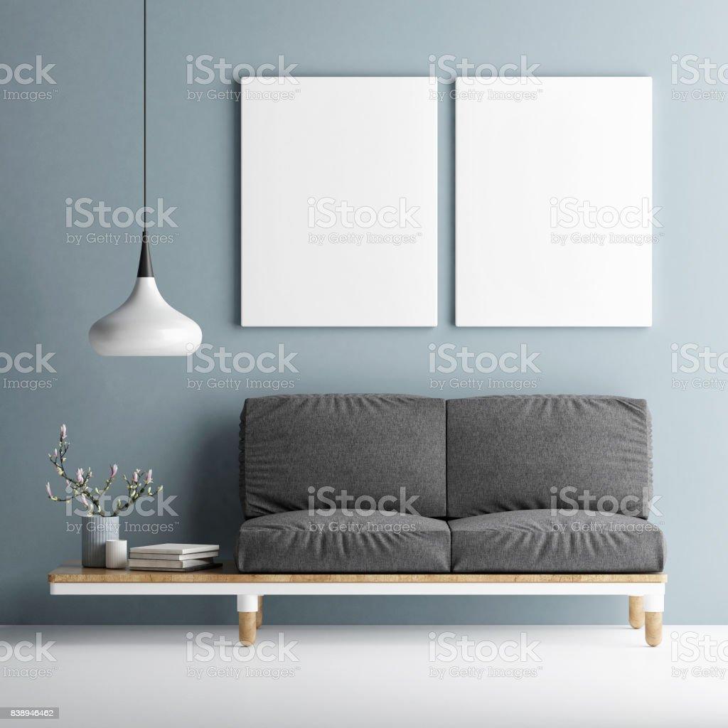 Sofa mit zwei Mock-up Poster auf blaue Wand – Foto