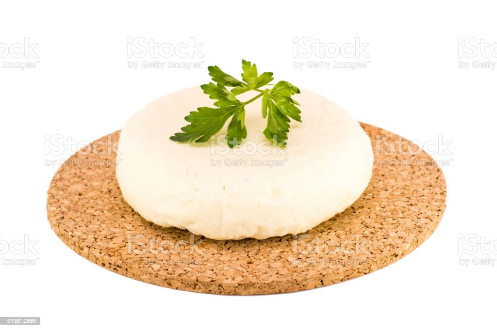 Soft Adyghe cheese on a white background stock photo