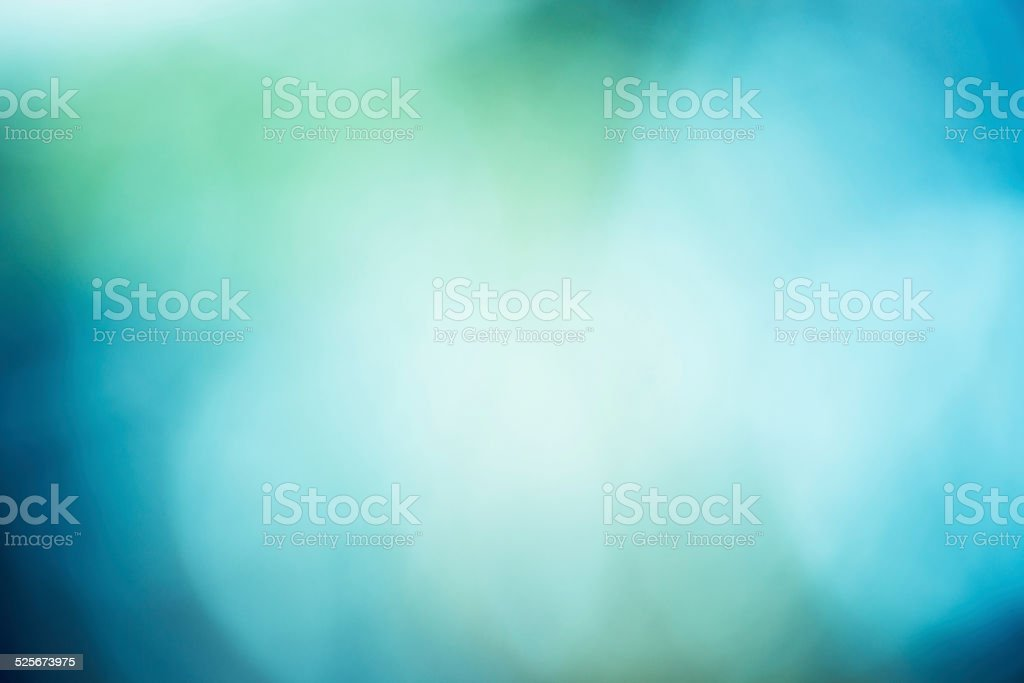 Soft and dreamy bokeh holiday winter nature background  misty blue stock photo