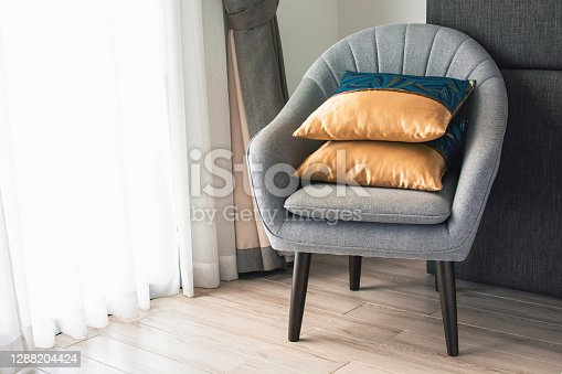 Soft armchair with pillows in the hotel room. The concept of old age and tranquility