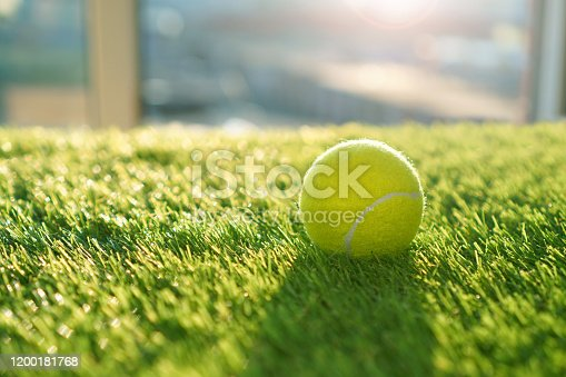 Soft artificial grass background with tennis ball
