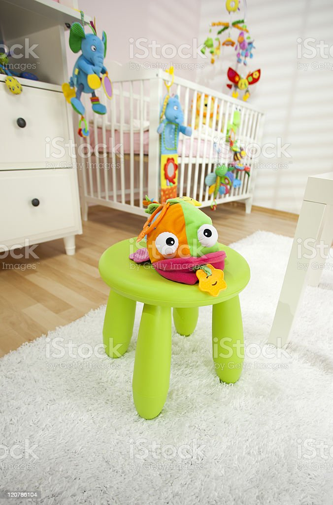 Soft Baby Toys In Nursery Room royalty-free stock photo