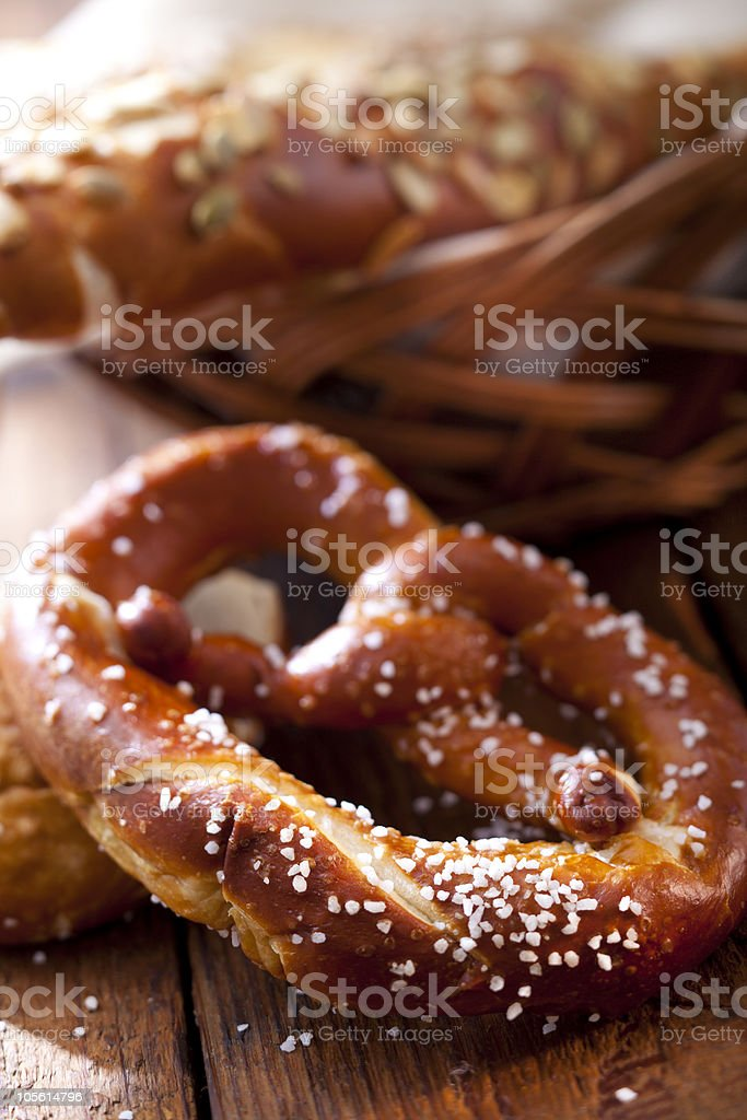 Soft baked salted pretzel and bread basket royalty-free stock photo