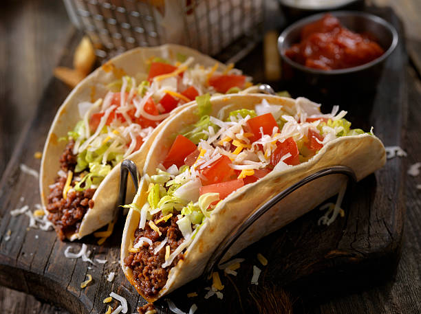 soft beef tacos with fries - mexican food stock photos and pictures