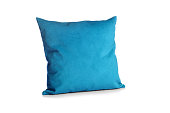 Soft blue pillow isolated on white background.