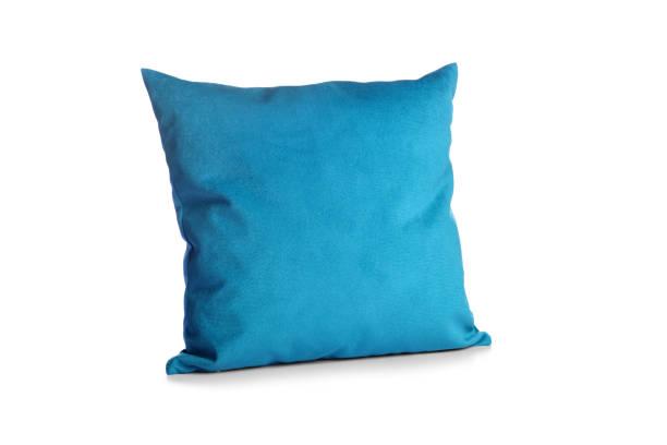 soft blue pillow isolated on white background - подушка стоковые фото и изображения