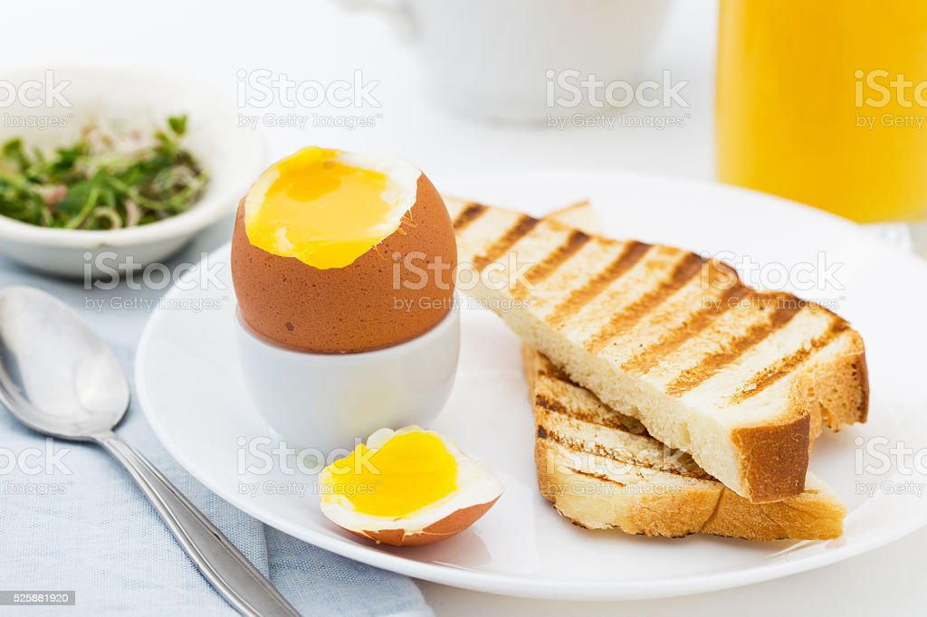 Soft boiled egg with toast for rich breakfast. stock photo