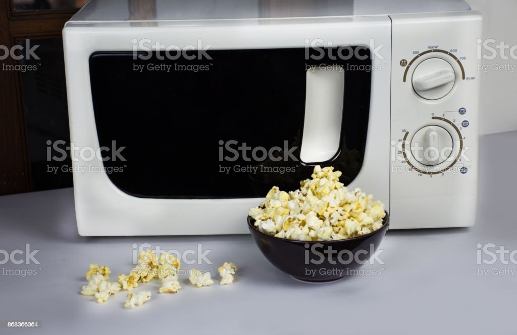 Soft butter popcorn after the cooking in the microwave oven stock photo