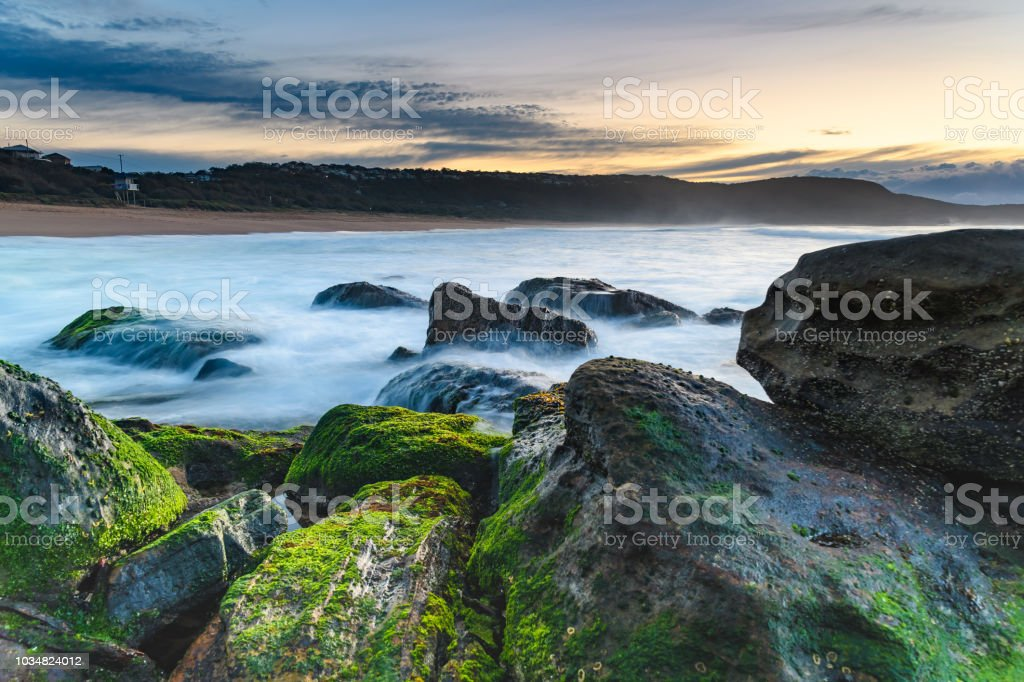 Soft Cascades and Green Moss Sunrise Seascape stock photo
