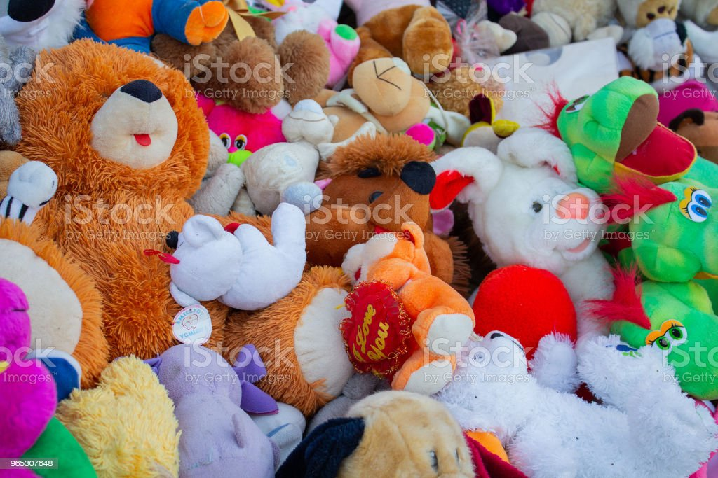 Soft children's toys piled in a heap zbiór zdjęć royalty-free