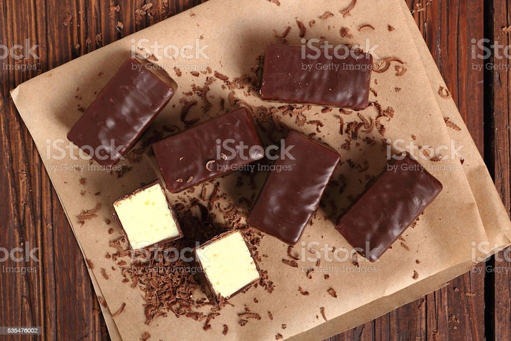 Soft Chocolate Covered Candy Filled With Soft Lemon Meringue Stock