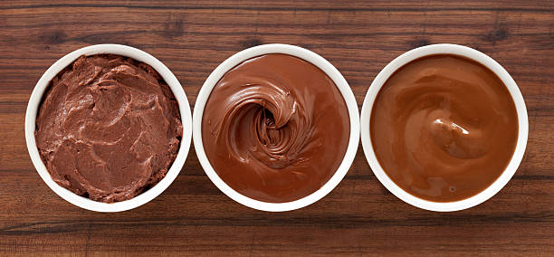 Soft chocolates Three bowls containing soft chocolate stuff (mousse, spread and pudding) pudding stock pictures, royalty-free photos & images