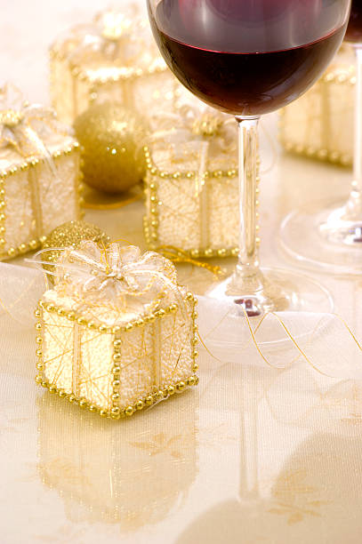 Soft Christmas Decoration with Gifts, Ribbon, Wine and Baubles stock photo