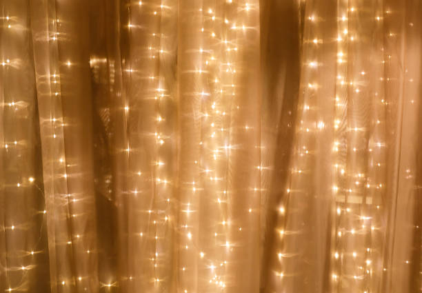 zachte gordijn met string lichten - snoerverlichting stockfoto's en -beelden