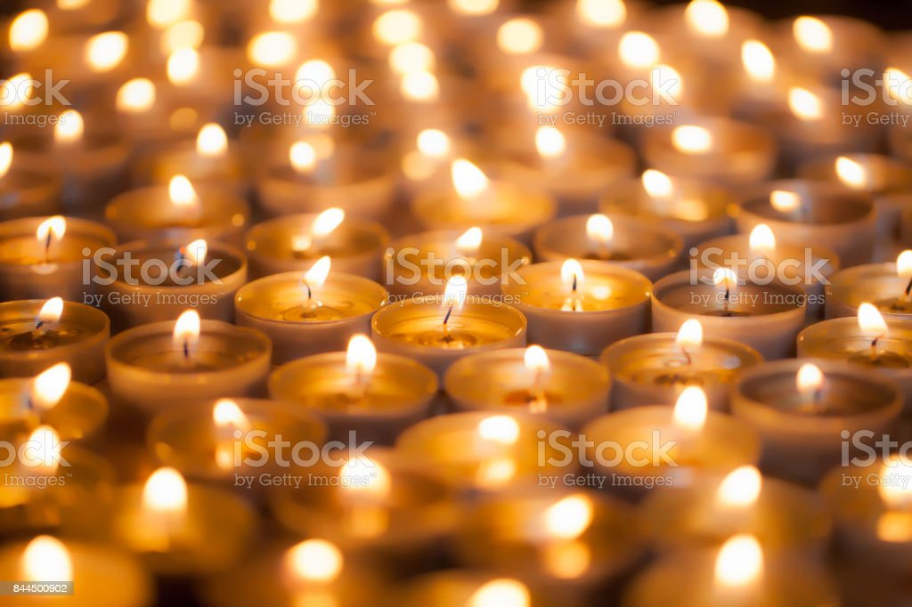 Soft dreamy image of bright candlelight from burning tea light candles. Christmas background image. stock photo