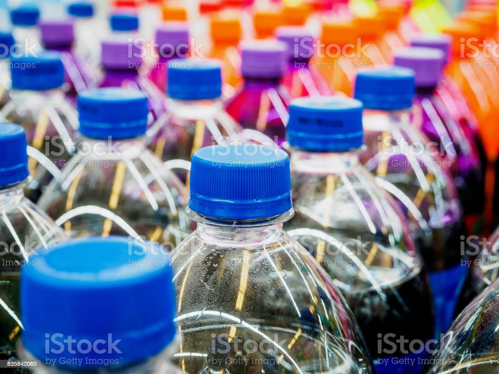 soft drinks bottles in supermarket stock photo