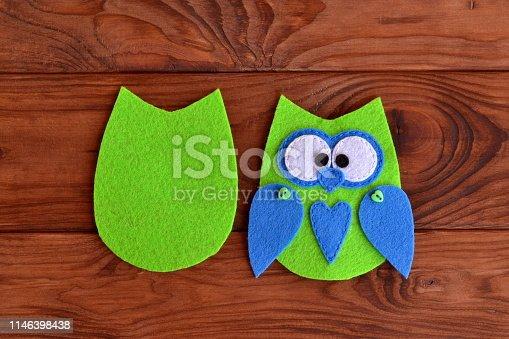 istock Soft felt toy pattern. Children sewing tutorial. Needlecraft sewing felt pattern. Felt body of a fabric owl. Stitched details toy 1146398438
