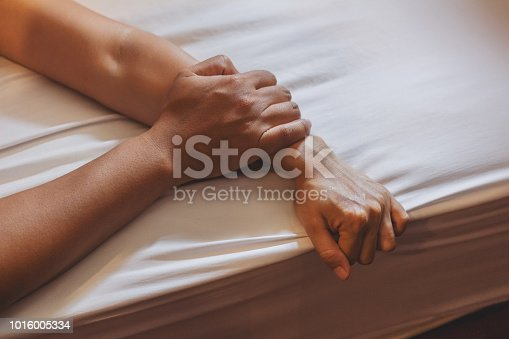 Soft focus a hairy man's hand holding a woman hand for rape and sexual abuse concept