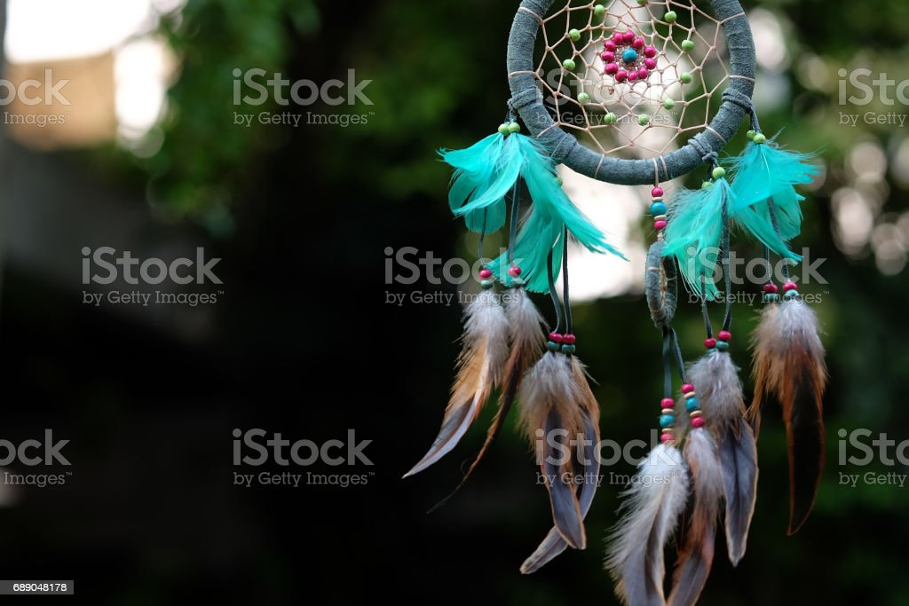 Soft focus and blurred Dream Catcher Blue Coral with natural background in vintage style. boho chic, ethnic amulet. stock photo