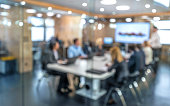 Soft focus of business people having presentation in conference room during meeting.