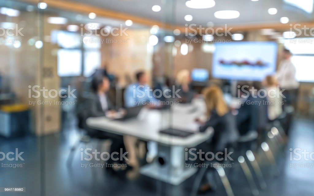 Soft focus business people sitting in conference room stock photo