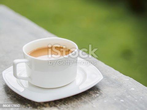 istock Soft focus coffee cup in garden. 860812850