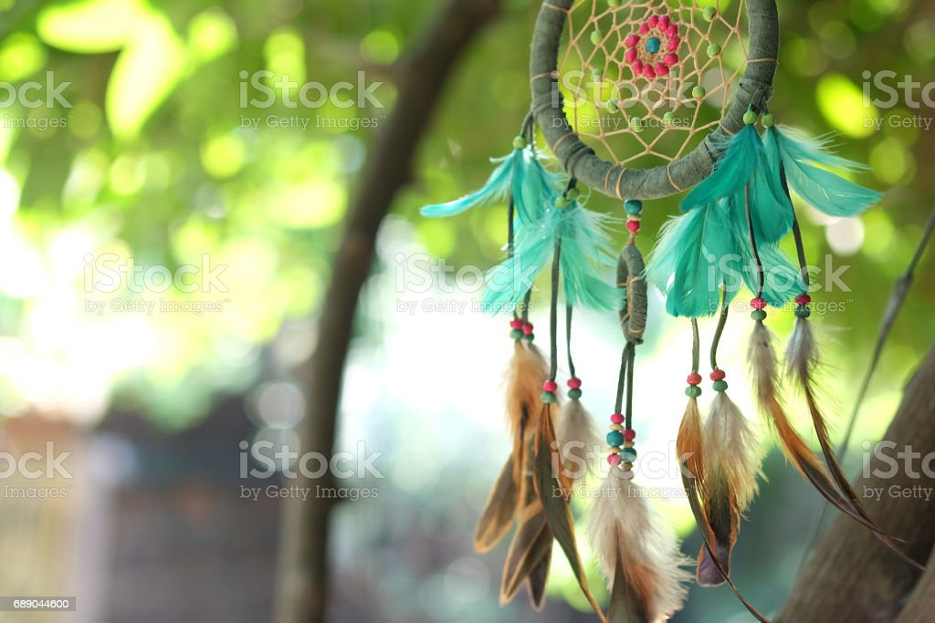 Soft focus dream catcher blue coral and natural bokeh background selective focus and blurry. Native american dream catcher. (Vintage style) boho chic, ethnic amulet. stock photo