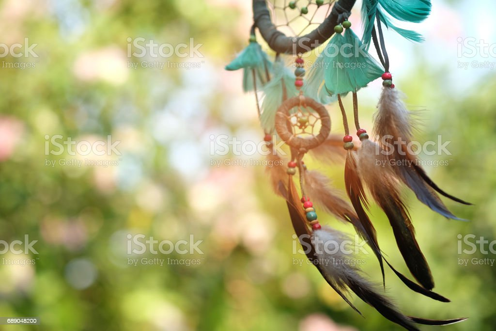 Soft focus dream catcher blue coral and natural bokeh background selective focus and blurry. Native american dream catcher. boho chic, ethnic amulet. stock photo